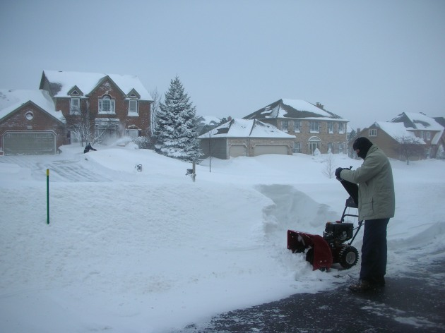 Kelly's husband with a snow blower