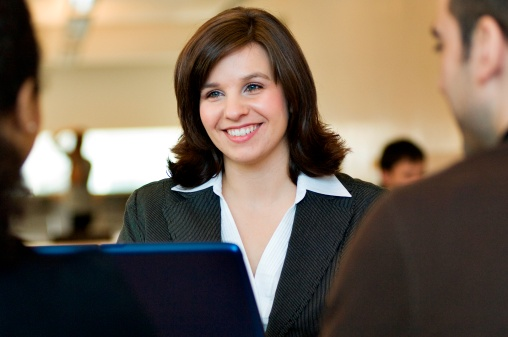 business lady assisting clients